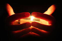 hands holding candle cropped.jpg?1437360